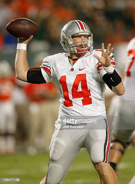 Joe Bauserman of the Ohio State Buckeyes throws the ball against the Miami Hurricanes on September 17 2011 at Sun Life Stadium in Miami Florida