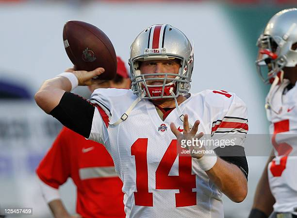Joe Bauserman of the Ohio State Buckeyes throws the ball prior to the game against the Miami Hurricanes on September 17 2011 at Sun Life Stadium in...