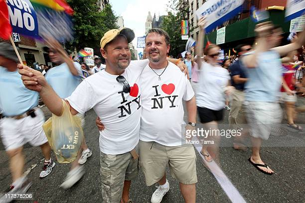 Joe Bednar and Phil Mason look on during the Gay Pride parade on June 26 2011 in New York City The parade took on extra significance following Friday...