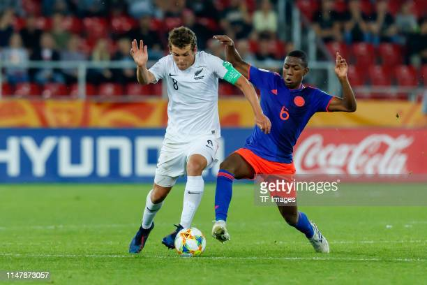 Joe Bell of New Zealand and Andres Perea of Colombia battle for the ball during the 2019 FIFA U20 World Cup Round of 16 match between Colombia and...