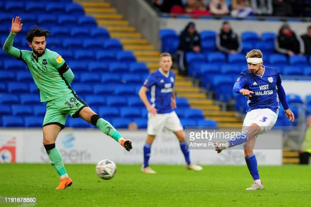 Joe Bennett of Cardiff City has a shot during the FA Cup third round match between Cardiff City and Carlisle United at the Cardiff City Stadium on...