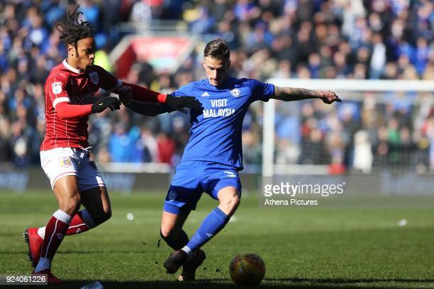 Joe Bennett of Cardiff City is challenged by Bobby Reid of Bristol City during the Sky Bet Championship match between Cardiff City and Bristol City...