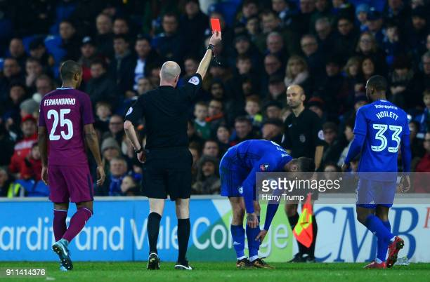 Joe Bennett of Cardiff City is shown a red card by referee Lee Mason during The Emirates FA Cup Fourth Round between Cardiff City and Manchester City...