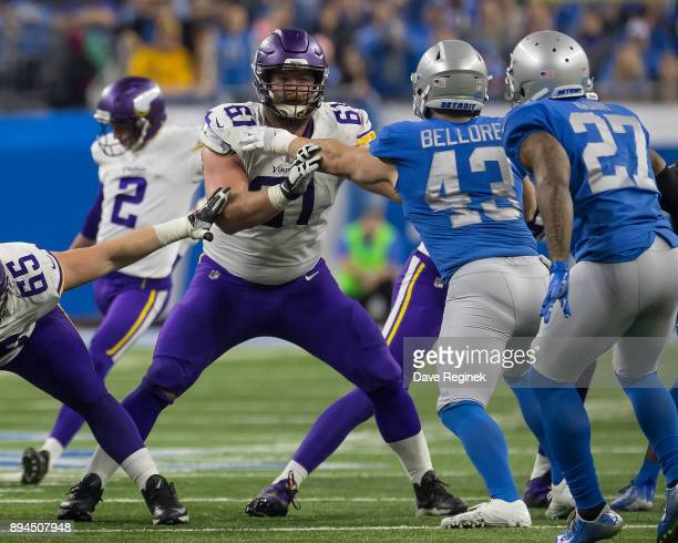 Joe Berger of the Minnesota Vikings blocks against Nick Bellore of the Detroit Lions during an NFL game at Ford Field on November 23, 2016 in...