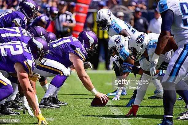 Joe Berger of the Minnesota Vikings lines up to snap the ball against the Tennessee Titans during the first half at Nissan Stadium on September 11...