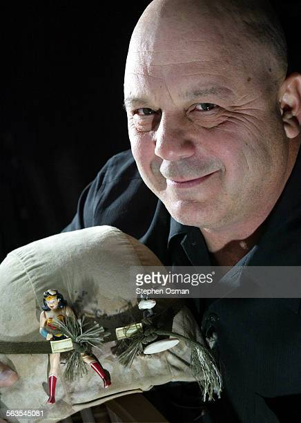 Joe Berlin with his military helmet he used while in guard duty in Iraq The toys attached to helmet are gifts from his daughters that he keep for...
