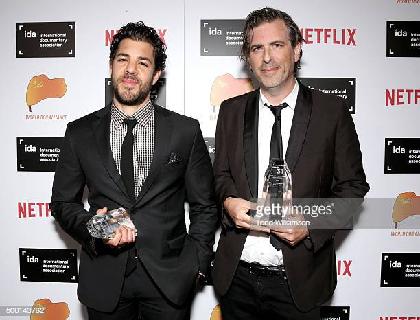 Joe Beshenkovsky and director Brett Morgen pose with the Best Editing award at the 2015 IDA Awards at Paramount Studios on December 5 2015 in...