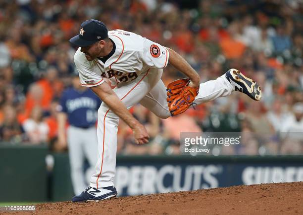 Joe Biagini of the Houston Astros pitches in the eighth inning against the Seattle Mariners at Minute Maid Park on August 03 2019 in Houston Texas