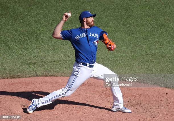 Joe Biagini of the Toronto Blue Jays delivers a pitch in the eighth inning during MLB game action against the Tampa Bay Rays at Rogers Centre on...