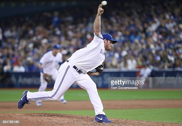 Joe Biagini of the Toronto Blue Jays delivers a pitch in the eighth inning during MLB game action against the Boston Red Sox on May 27 2016 at Rogers...
