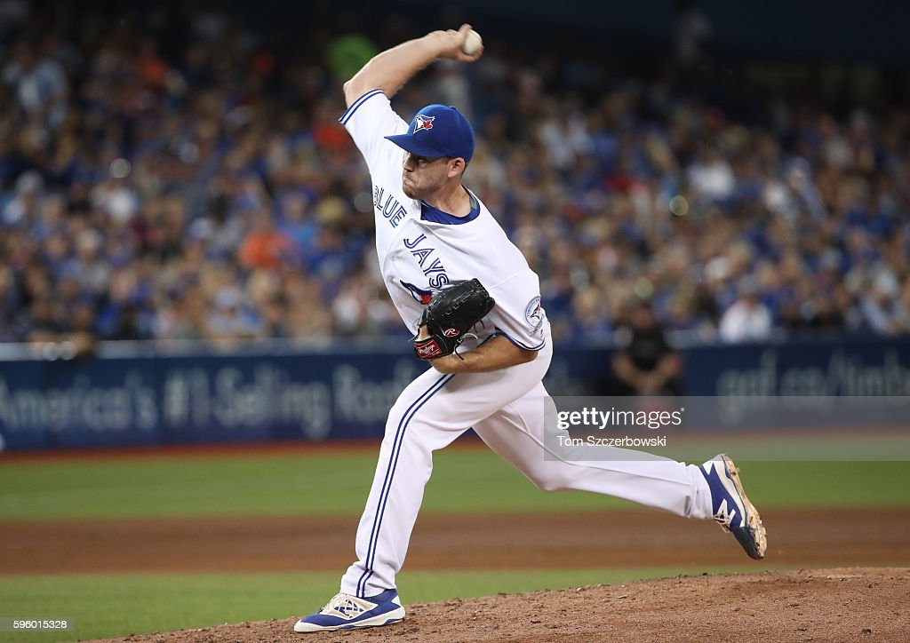 Joe Biagini #31 of the Toronto Blue Jays delivers a pitch in the sixth inning during MLB game action against the Minnesota Twins on August 26, 2016 at Rogers Centre in Toronto, Ontario, Canada.