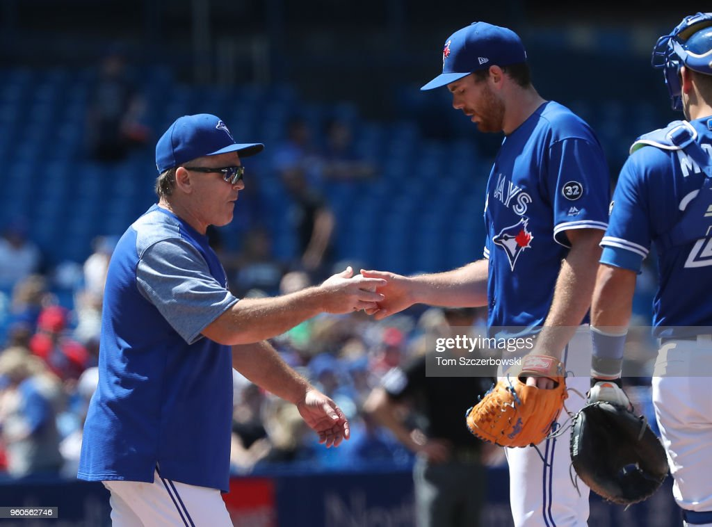 Joe Biagini #31 of the Toronto Blue Jays exits the game as he is relieved by manager John Gibbons #5 in the fifth inning during MLB game action against the Oakland Athletics at Rogers Centre on May 20, 2018 in Toronto, Canada.