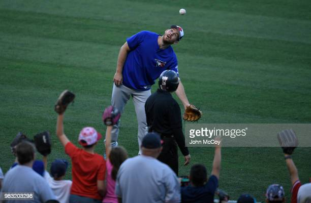 Joe Biagini of the Toronto Blue Jays jokes with the fans before playing the Los Angeles Angels of Anaheim at Angel Stadium on June 22 2018 in Anaheim...