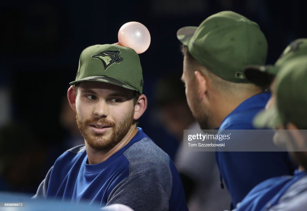 Joe Biagini #31 of the Toronto Blue Jays talks to Marco Estrada #25 while unaware of the bubble on his hat during MLB game action against the Cincinnati Reds at Rogers Centre on May 29, 2017 in Toronto, Canada.