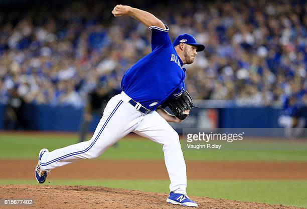 Joe Biagini of the Toronto Blue Jays throws a pitch in the eighth inning against the Cleveland Indians during game five of the American League...