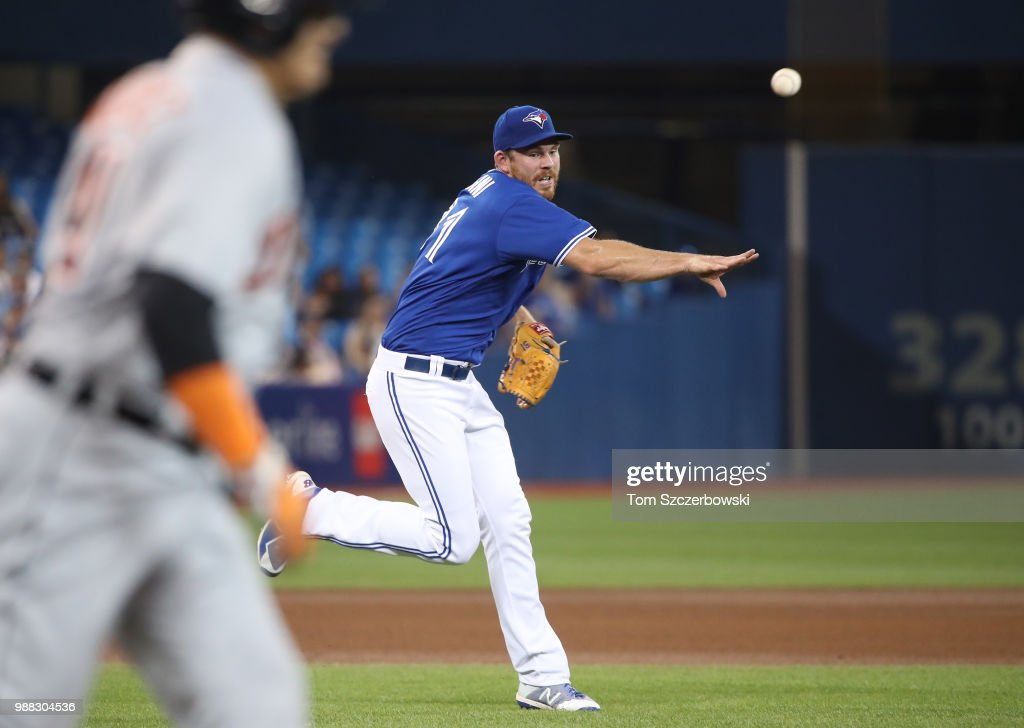 Joe Biagini #31 of the Toronto Blue Jays throws out Victor Martinez #41 of the Detroit Tigers after fielding a grounder in the eighth inning during MLB game action at Rogers Centre on June 30, 2018 in Toronto, Canada.
