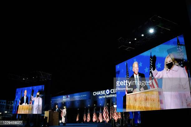 Joe Biden, 2020 Democratic presidential nominee, left, and wife Jill Biden arrive on stage during an election night party in Wilmington, Delaware,...