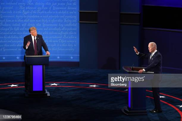 Joe Biden, 2020 Democratic presidential nominee, right, and U.S. President Donald Trump speak during the first U.S. Presidential debate hosted by...