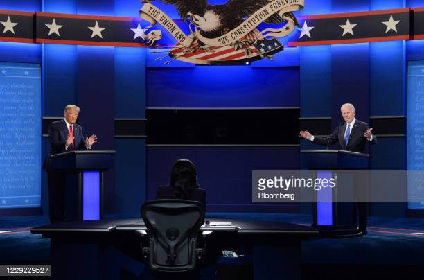 Joe Biden, 2020 Democratic presidential nominee, right, and U.S. President Donald Trump speak during the U.S. Presidential debate at Belmont...