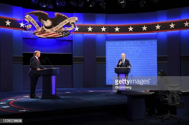 Joe Biden, 2020 Democratic presidential nominee, speaks as U.S. President Donald Trump, left, listens during the U.S. Presidential debate at Belmont...