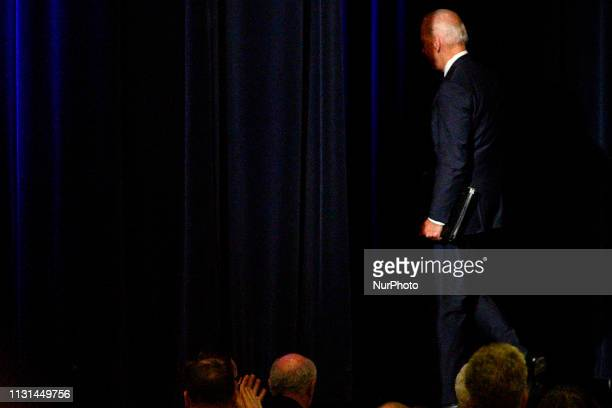 Joe Biden departs the stage after delivering the keynote speech at the First State Democratic Dinner at the Rollins Center in Dover DE on March 16...