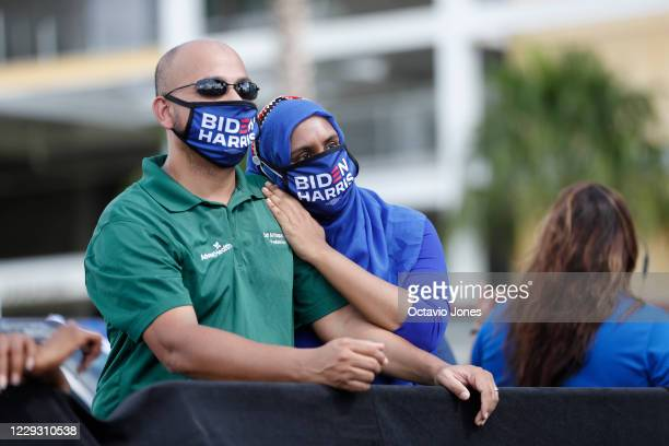 Joe Biden for President supporters Dr Saif Al Haque and his wife Nuren Haider looks on while former President Barack Obama campaigns for Democratic...