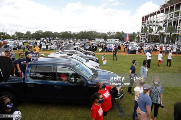 Joe Biden for President supporters looks on from the their vehicles while former President Barack Obama campaigns for Democratic presidential nominee...