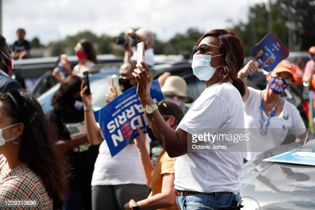 Joe Biden for President supporters looks on while former President Barack Obama campaigns for Democratic presidential nominee Joe Biden at Camping...