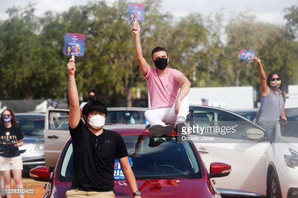 Joe Biden for President supporters Nick Ortega and Louis Scuderi cheer while former President Barack Obama campaigns for Democratic presidential...