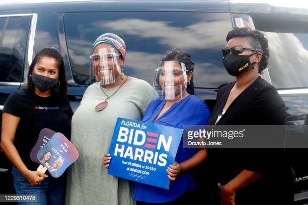 Joe Biden for President supporters pose for a photo while former President Barack Obama campaigns for Democratic presidential nominee Joe Biden at...