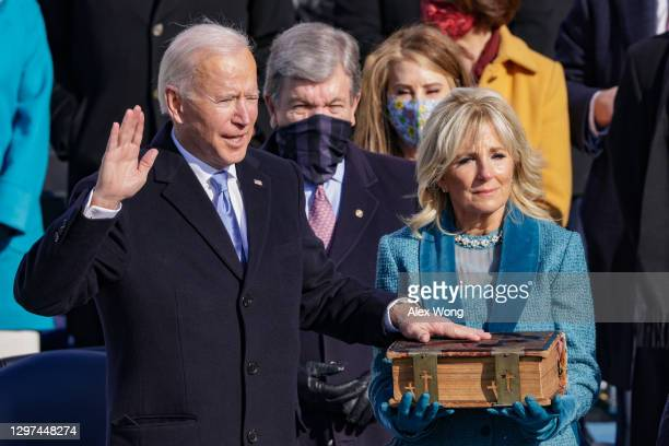Joe Biden is sworn in as U.S. President as his wife Dr. Jill Biden looks on during his inauguration on the West Front of the U.S. Capitol on January...