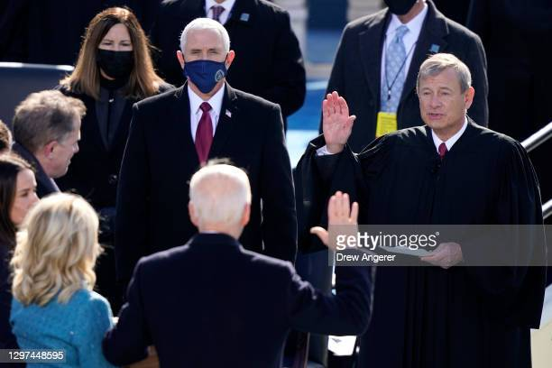 Joe Biden is sworn in as U.S. President by U.S. Supreme Court Chief Justice John G. Roberts during his inauguration on the West Front of the U.S....