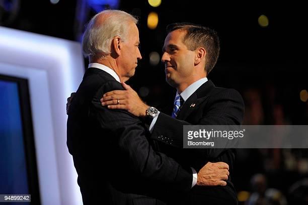 Joe Biden left a Democratic senator from Delaware and vice presidential running mate of presidential candidate Senator Barack Obama of Illinois hugs...