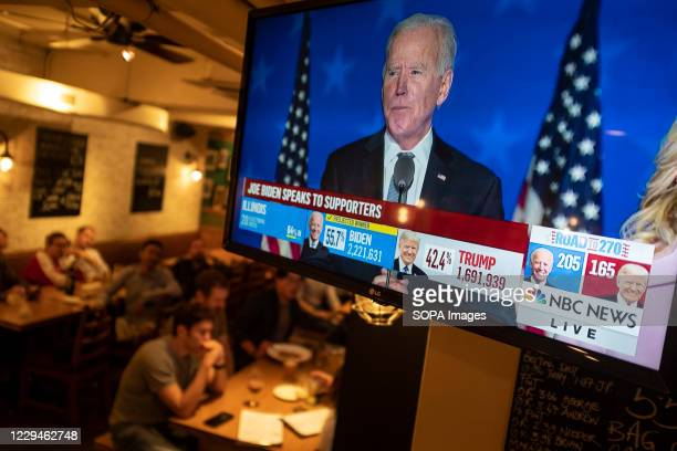 Joe Biden speaks to supporters during the US Presidential election show on a live screen at a bar. U.S. President Donald Trump falsely declared early...
