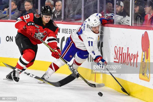 Joe Blandisi of the Binghamton Devils challenges Daniel Carr of the Laval Rocket during the AHL game at Place Bell on October 13 2017 in Laval Quebec...