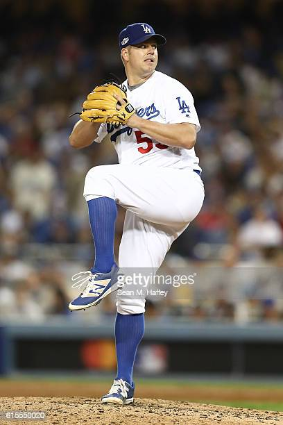 Joe Blanton of the Los Angeles Dodgers delivers a pitch against the Chicago Cubs in the seventh inning of game three of the National League...