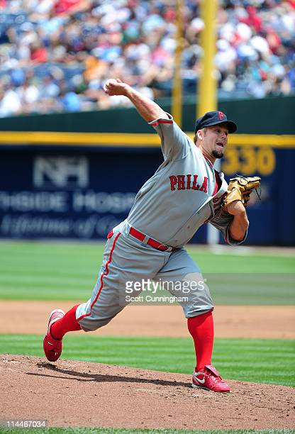 Joe Blanton of the Philadelphia Phillies pitches against the Atlanta Braves during Civil Rights Weekend at Turner Field on May 14 2011 in Atlanta...