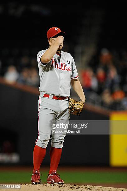 Joe Blanton of the Philadelphia Phillies reacts after throwing a pitch in the first inning against the New York Mets at Citi Field on September 24...