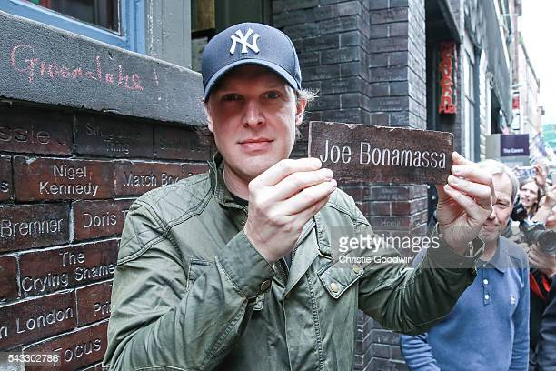 Joe Bonamassa is inducted in the Cavern Wall of Fame ahead of his concert at The Cavern on June 27 2016 in Liverpool England