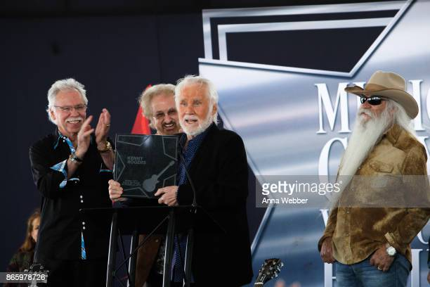 Joe Bonsall Duane Allen William Lee Golden and Richard Sterban of the Oak Ridge Boys present Kenny Rogers with the 20th Walk of Fame award as Kenny...