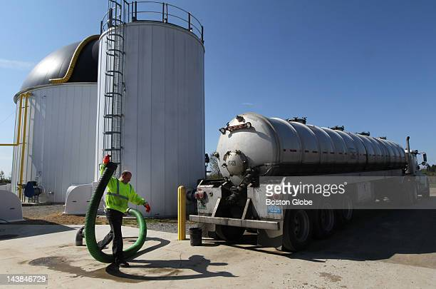 Joe Bouchard of Casella Waste Systems prepares to offload food waste at the anaerobic digestive plant at the Jordan Dairy Farm The plant converts cow...