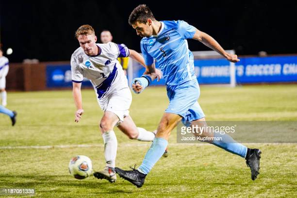 Joe Braun of Tufts Jumbos crosses the ball during the Division III Men's Soccer Championship held at UNCG Soccer Stadium on December 7 2019 in...