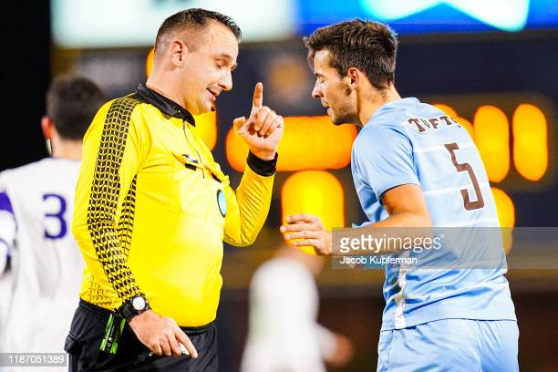 Joe Braun of Tufts Jumbos talks with the ref during the Division III Men's Soccer Championship held at UNCG Soccer Stadium on December 7 2019 in...