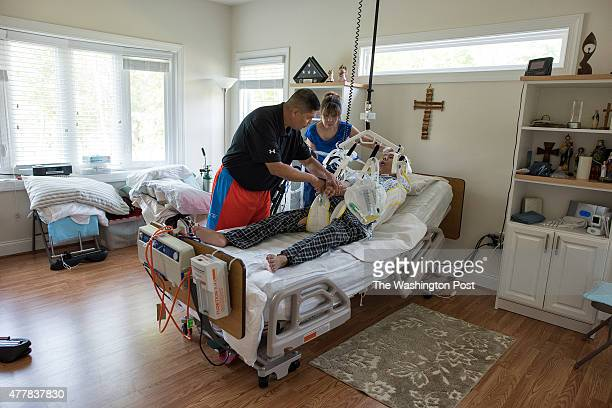Joe Briseno and Eva Briseno at home with their son Jay Briseno on June 11 2015 in Manassas Virginia Specialist 4th Class Jay Briseno was shot in the...