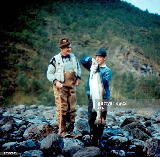 Joe Brooks and another angler stand on a rocky bank with their catch from the Alta River in Norway in February of 1974