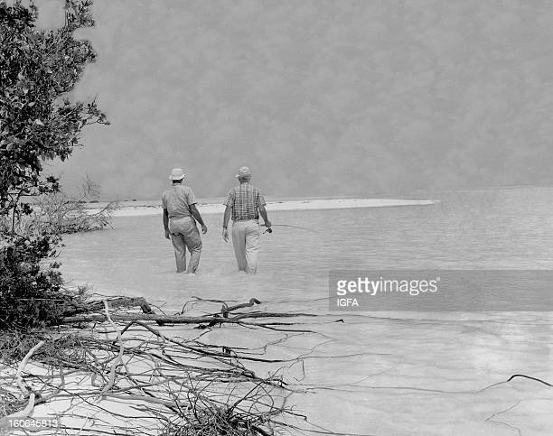 Joe Brooks and another angler wade the flats looking for bonefish in St Croix US Virgin Islands circa 1960