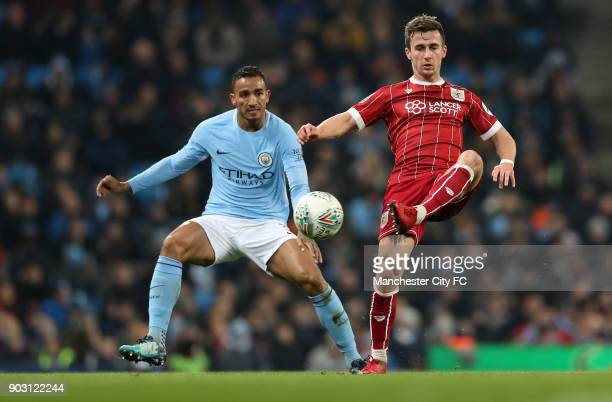 Joe Bryan of Bristol City and Danilo of Manchester City during the Carabao Cup SemiFinal First Leg between Manchester City and Brostol City at Etihad...