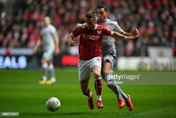 Joe Bryan of Bristol City is challenged by Matteo Darmian of Manchester United during the Carabao Cup QuarterFinal match between Bristol City and...