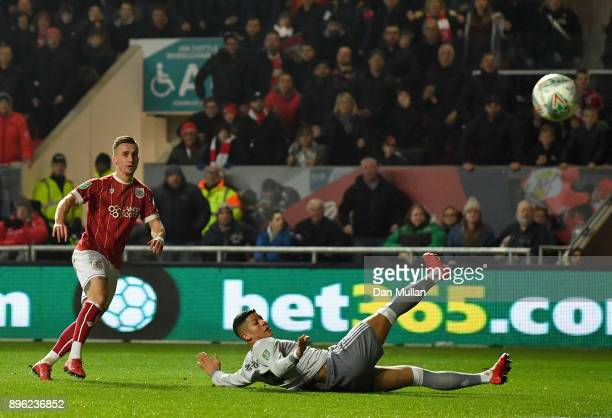 Joe Bryan of Bristol City scores his sides first goal during the Carabao Cup QuarterFinal match between Bristol City and Manchester United at Ashton...