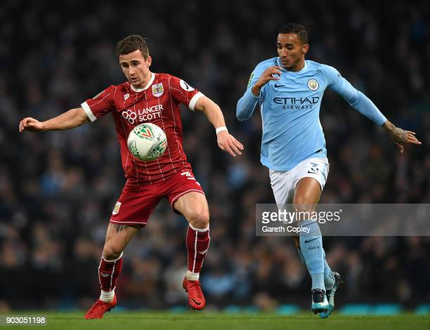 Joe Bryan of Bristol City shields the ball from Danilo of Manchester City during the Carabao Cup SemiFinal First Leg match between Manchester City...